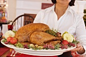 Woman serving roast turkey for Christmas