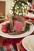 Roast rib of beef on Christmas table