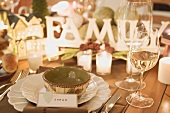 Christmas place-setting with place card, wine glasses