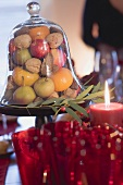 Fruit and nuts under glass dome (Christmas)