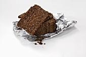 Slices of black bread in aluminium foil