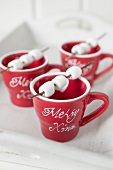 Marshmallows on sticks on red cups (Christmas)