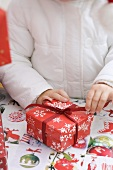 Child opening Christmas parcel