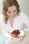 Woman holding berry muesli