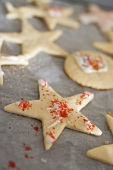 Biscuits with sugar sprinkles on baking parchment