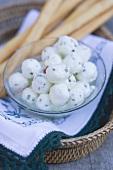 Marinated mozzarella balls with grissini