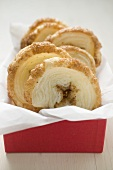 Palmiers (puff pastry biscuits) in red box