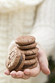 Hand holding chocolate macaroons