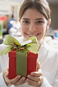 Young woman holding Christmas gift