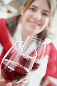 Young woman raising glass of wine (Christmas)