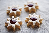 Four jam biscuits with icing sugar