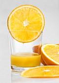 Glass of orange juice and orange slices