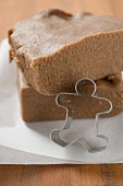 Gingerbread dough and biscuit cutter