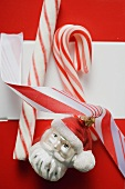 Christmas parcel with candy canes & Christmas tree ornament