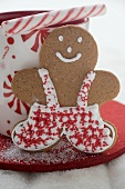Gingerbread man, candy cane and festive cup