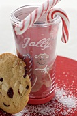 Christmas drink with candy canes and cranberry cookie