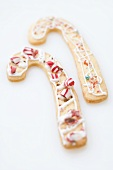 Two Christmas biscuits in the shape of candy canes