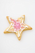A star biscuit decorated with pink sugar