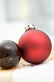 Two Christmas baubles on Christmas parcel