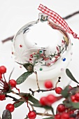 Silver Christmas bauble and berry branch