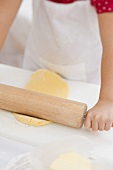 Small girl rolling out dough