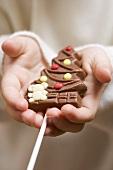 Child holding chocolate Christmas tree
