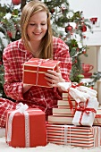 Woman looking at Christmas parcel