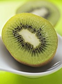Half a kiwi fruit in dish
