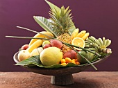 Still life: exotic fruit in wooden bowl