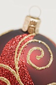 Red Christmas bauble with gold design (detail)