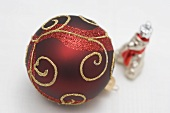 Red Christmas bauble with gold decoration and silver bear