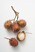 A cluster of three rambutans, two unattached