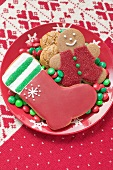 Christmas biscuits and chocolate beans on plate