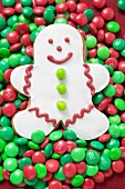White gingerbread man on red and green chocolate beans