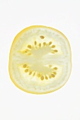 Slice of yellow tomato from above