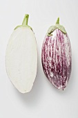 Two aubergine halves side by side