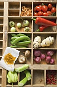 Various types of vegetables, spices & mushrooms in type case