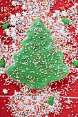 Christmas tree biscuit with coloured sprinkles