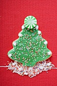 Christmas tree biscuit with coloured sprinkles & mint sweet