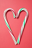 Two candy canes forming a heart