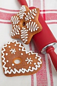 Gingerbread and rolling pin on tea towel