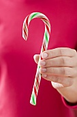 Woman holding candy cane