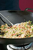 Frying vegetable rice in wok