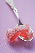 Two jelly hearts on silver spoon