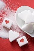 Sugar lumps, heart-shaped and with red hearts