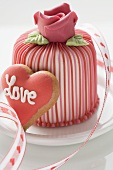 Marzipan-covered cake & heart-shaped biscuit (Valentine's Day)