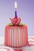 Marzipan-covered cake with candle