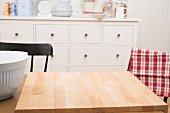 Kitchen scene with large chopping board on table