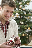Man holding Christmas parcel