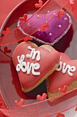 Purple fabric heart and biscuits for Valentine's Day